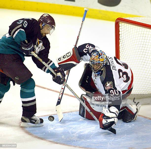 Petr Sykora of the Ducks tries to control the puck as Blue Jackets' goalie Mark Denis makes the stop in the third period Sunday at the Pond in Anaheim