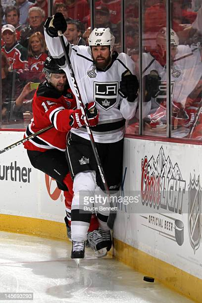 Petr Sykora of the New Jersey Devils checks Willie Mitchell of the Los Angeles Kings during Game Two of the 2012 NHL Stanley Cup Final at the...
