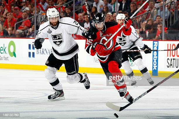 Petr Sykora of the New Jersey Devils skates for the puck against Jarret Stoll of the Los Angeles Kings during Game Five of the 2012 NHL Stanley Cup...