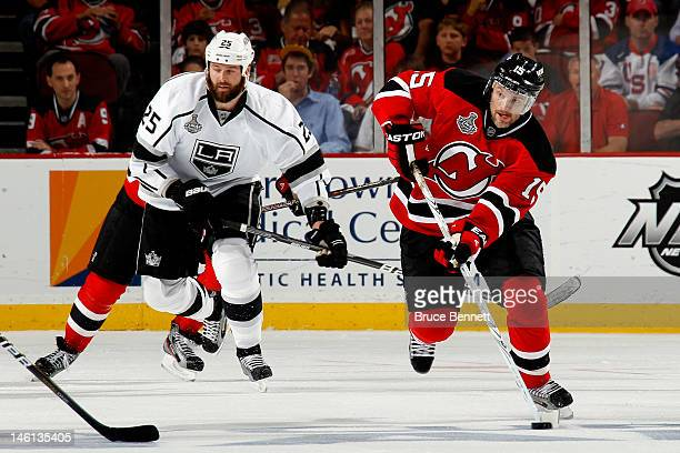 Petr Sykora of the New Jersey Devils skates for the puck against Dustin Penner of the Los Angeles Kings during Game Five of the 2012 NHL Stanley Cup...