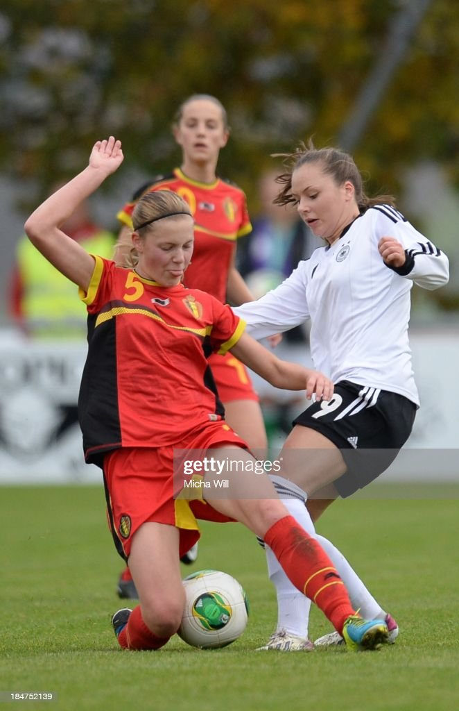 Petra Baldewijns (L) of Belgium and Laura Widak of Germany tussle for the ball during the U17 Girls Euro Qualifier match between Germany and Belgium at Bioenergie-Arena on October 16, 2013 in Grossbardorf, Germany.