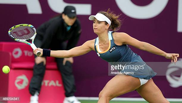 Petra Cetkovska of the Czech Republic returns the ball to Na Li of China during their women's singles tennis match on the fourth day of the Qatar...