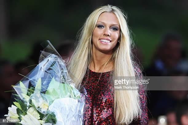 Petra Ecclestone is presented flowers for her clothes collection during the Amber Fashion Show and Auction held at the Meridien Beach Plaza on May 23...