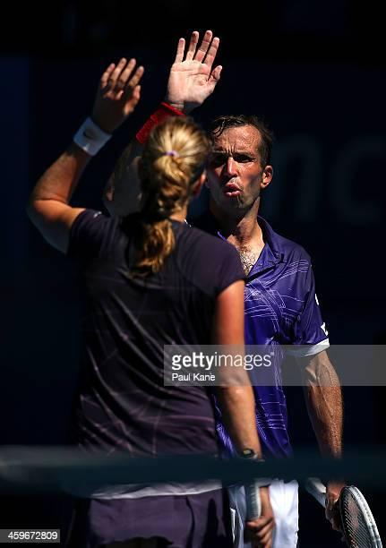 Petra Kvitova and Radek Stepanek of the Czech Republic celebrate defeating Anabel Medina Garrigues and Daniel MunozDe La Nava of Spain in the mixed...
