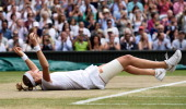 Petra Kvitova celebrates after beating Eugenie Bouchard in the ladies singles final on centre court during day twelve of the Wimbledon Championships...
