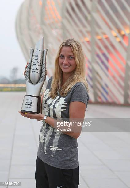 Petra Kvitova of Czech poses for photos with her trophy after winning her final match against Eugenie Bouchard of Canada on day seven of 2014...