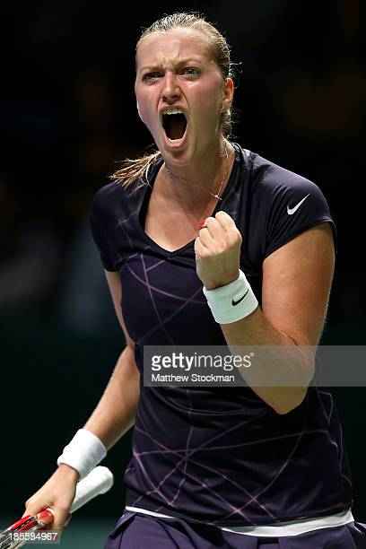 Petra Kvitova of Czech Republic celebrates a point against Agnieszka Radwanska of Poland during day one of the TEB BNP Paribas WTA Championships at...