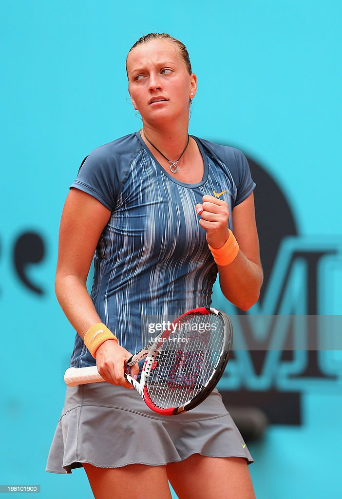 Petra Kvitova of Czech Republic celebrates winning a game against Yanina Wickmayer of Belgium during day two of the Mutua Madrid Open tennis tournament at the Caja Magica on May 5, 2013 in Madrid, Spain.