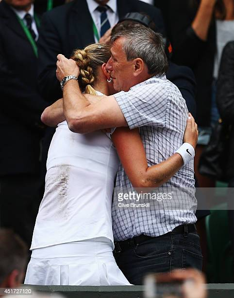 Petra Kvitova of Czech Republic celebrates with her father Jiri after winning the Ladies' Singles final match against Eugenie Bouchard of Canada on...