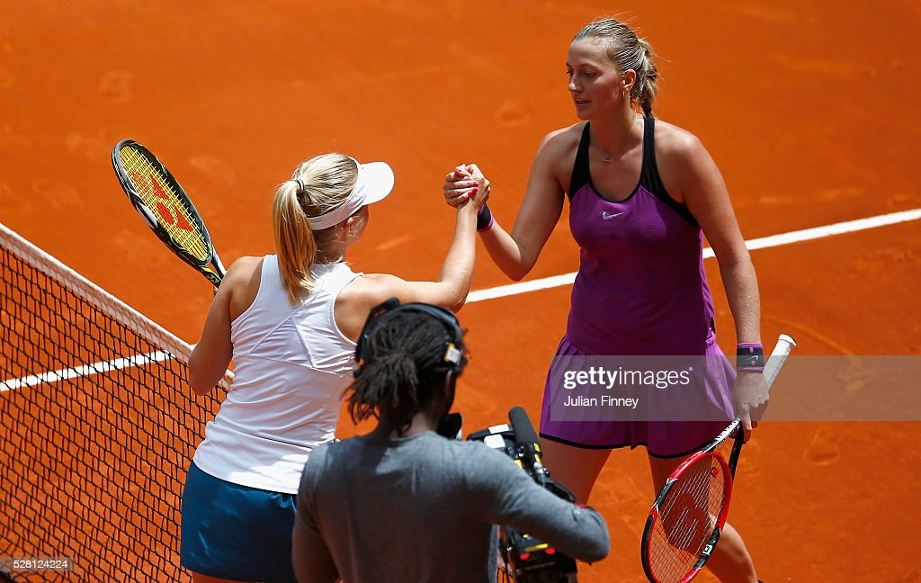 Petra Kvitova of Czech Republic congratulates <a gi-track='captionPersonalityLinkClicked' href=/galleries/search?phrase=Daria+Gavrilova&family=editorial&specificpeople=5906023 ng-click='$event.stopPropagation()'>Daria Gavrilova</a> of Australia after her straight sets win during day five of the Mutua Madrid Open tennis tournament at the Caja Magica on May 04, 2016 in Madrid, Spain.