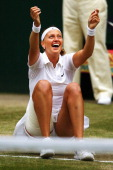 Petra Kvitova of Czech Republic falls to the floor as she celebrates championship point and winning the Ladies' Singles final match against Eugenie...