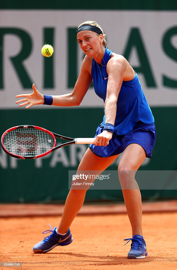 Petra Kvitova of Czech Republic hits a backhand during the Ladies Singles third round match against Shelby Rogers of the United States on day six of the 2016 French Open at Roland Garros on May 27, 2016 in Paris, France.