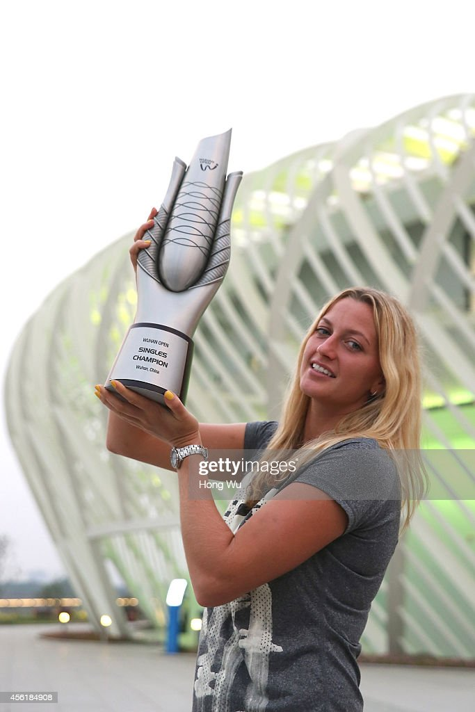 Petra Kvitova of Czech Republic holds the trophy to celebrate after she won the final match against Eugenie Bouchard of Canada on day seven of 2014...