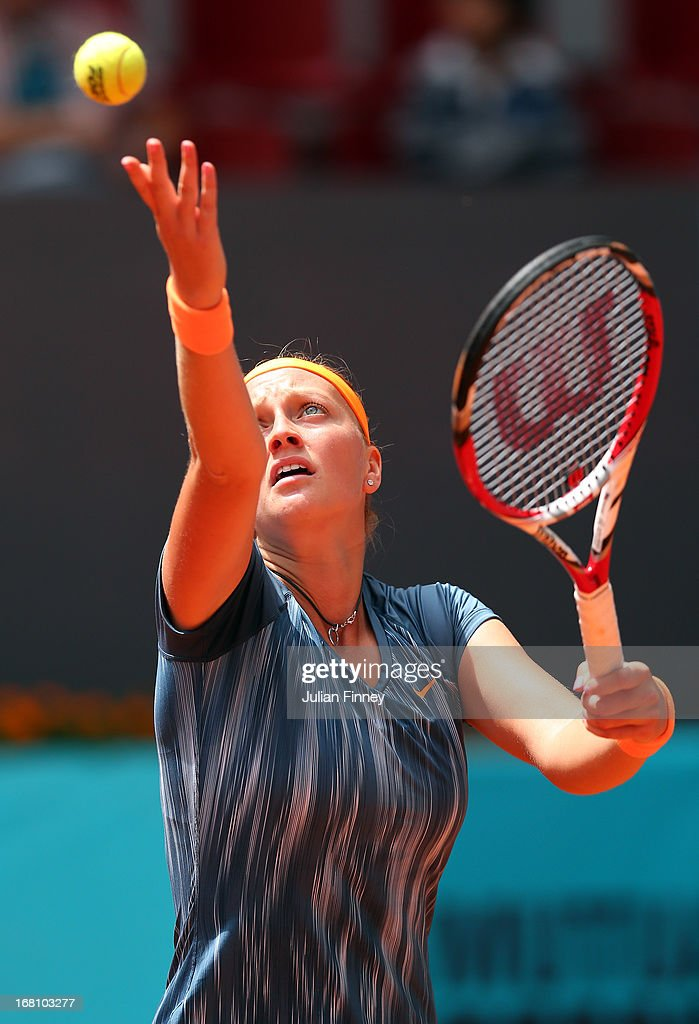 Petra Kvitova of Czech Republic in action against Yanina Wickmayer of Belgium during day two of the Mutua Madrid Open tennis tournament at the Caja Magica on May 5, 2013 in Madrid, Spain.