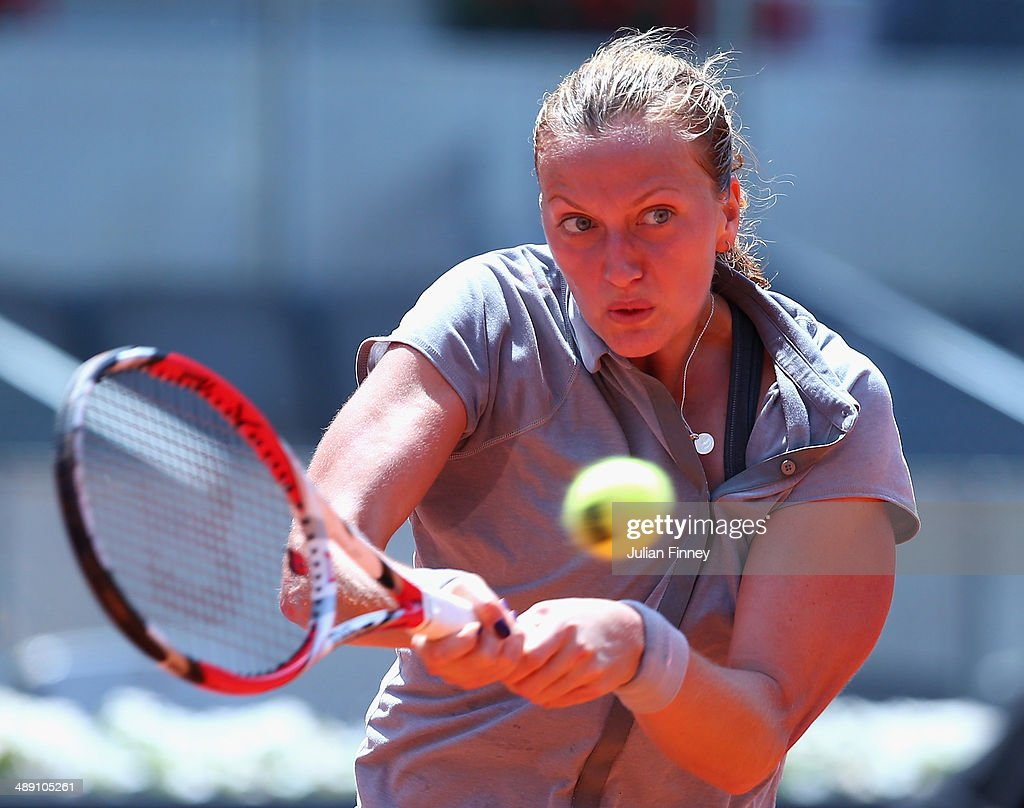 Petra Kvitova of Czech Republic in action in her match against Simona Halep of Romania during day eight of the Mutua Madrid Open tennis tournament at the Caja Magica on May 10, 2014 in Madrid, Spain.