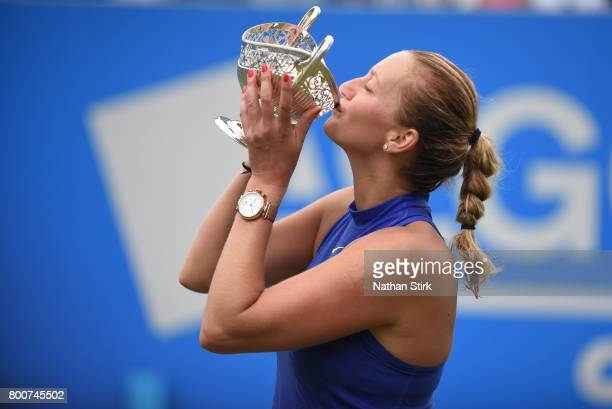 Petra Kvitova of Czech Republic kisses the Maud Watson trophy after beating Ashleigh Barty of Australia on day seven of The Aegon Classic Birmingham...