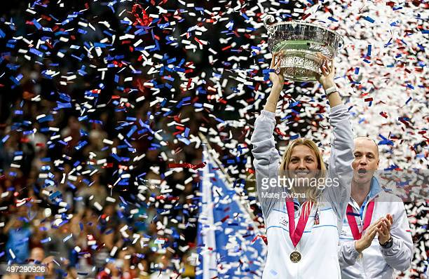 Petra Kvitova of Czech Republic lifts up the trophy as she celebrates with her teammates their win after the Fed Cup final match between Czech...