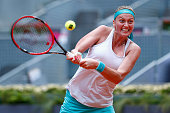 Petra Kvitova of Czech Republic plays a backhand in her match against Serena Williams of USA during day seven of the Mutua Madrid Open tennis...