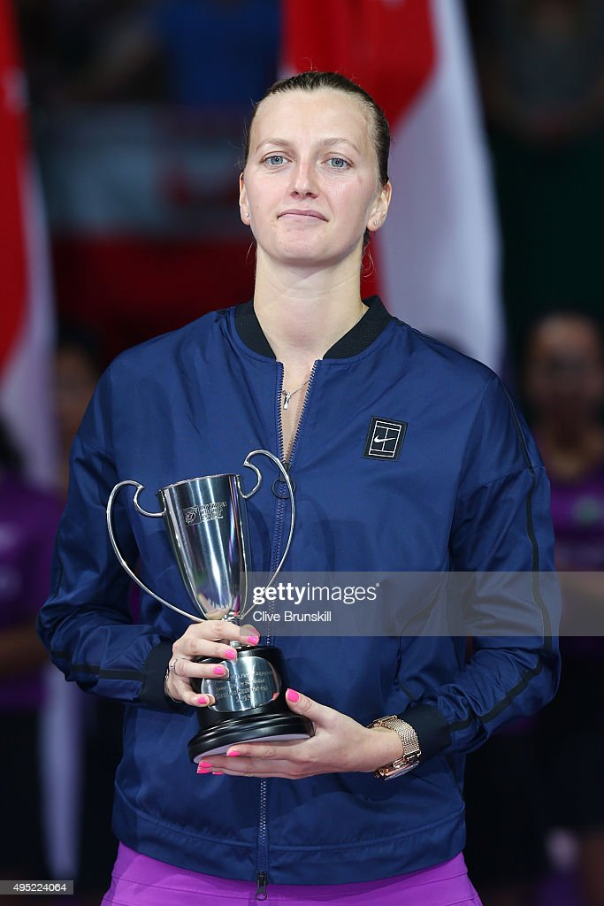 Petra Kvitova of Czech Republic poses with the runners-up trophy after her final match against Agnieszka Radwanska of Poland during the BNP Paribas WTA Finals at Singapore Sports Hub on November 1, 2015 in Singapore.