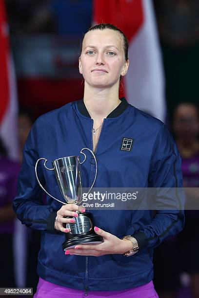 Petra Kvitova of Czech Republic poses with the runnersup trophy after her final match against Agnieszka Radwanska of Poland during the BNP Paribas...