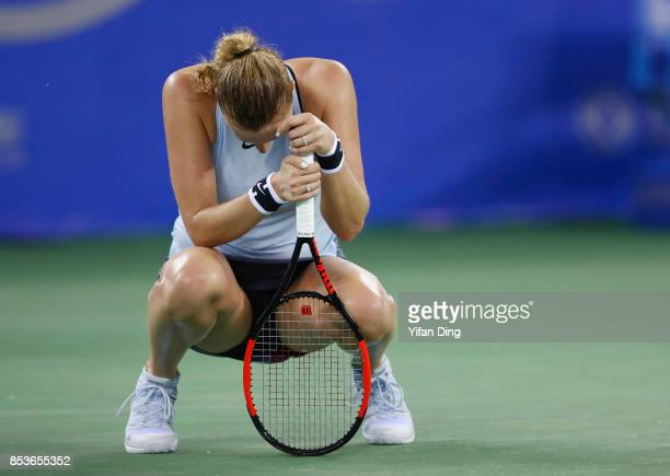 Petra Kvitova of Czech Republic reacts following her defeat Ladies Singles match against Peng Shuai of China in round 1 during Day 2 of 2017 Wuhan...