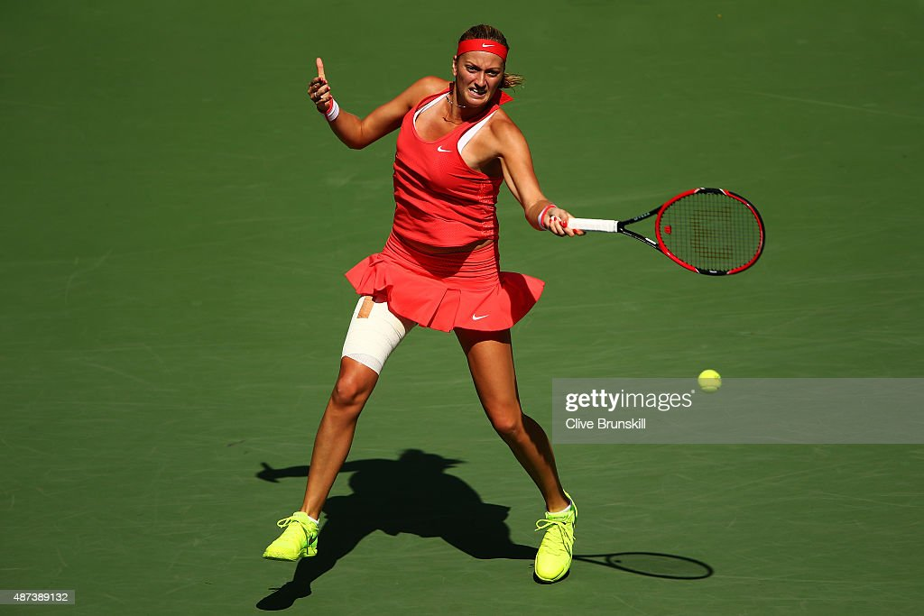Petra Kvitova of Czech Republic returns a shot to Flavia Pennetta of Italy during their Women's Singles Quarterfinals match on Day Ten of the 2015 US...
