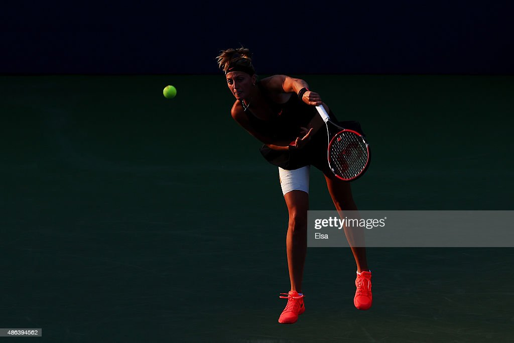 Petra Kvitova of Czech Republic serves to Nicole Gibbs of the United States during their Women's Singles Second Round match on Day Four of the 2015...