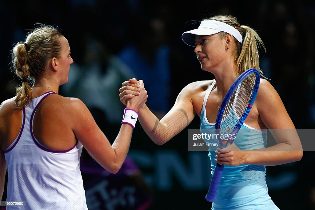 Petra Kvitova of Czech Republic shakes hands with Maria Sharapova of Russia after defeating her in the semi-final match of the BNP Paribas WTA Finals at Singapore Sports Hub on October 31, 2015 in Singapore.