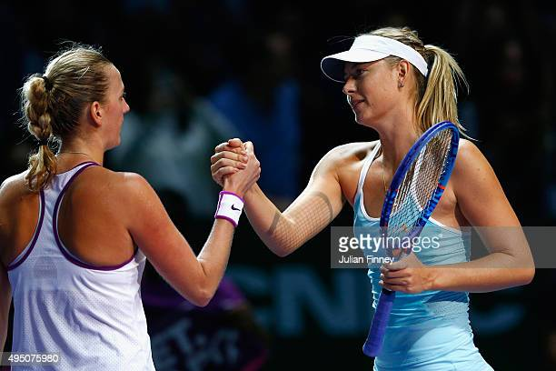 Petra Kvitova of Czech Republic shakes hands with Maria Sharapova of Russia after defeating her in the semifinal match of the BNP Paribas WTA Finals...