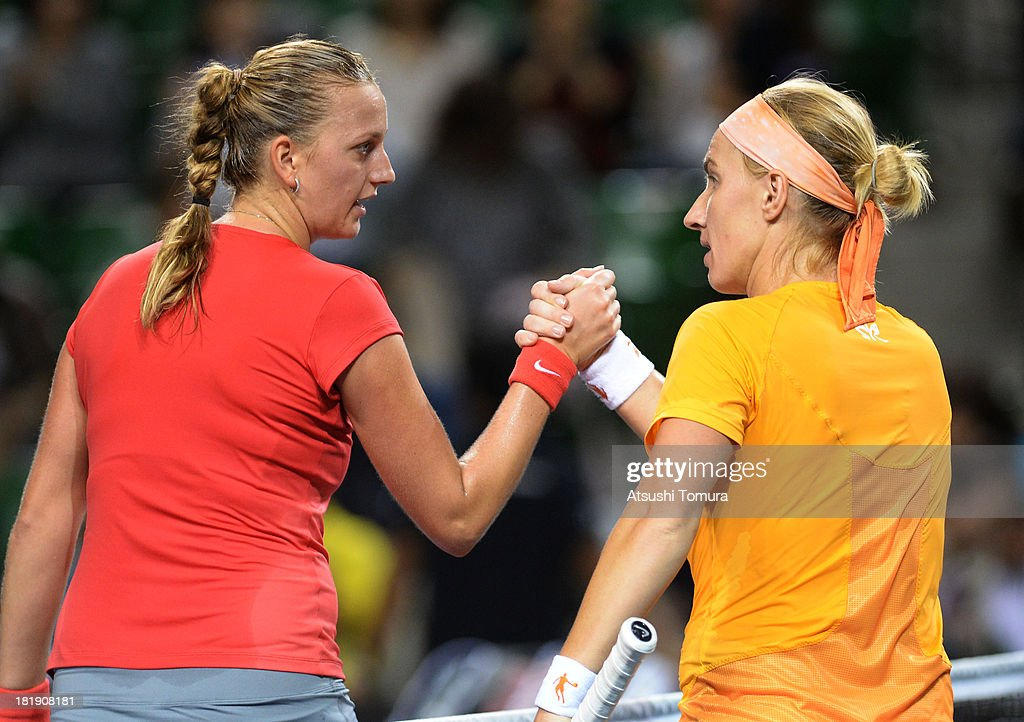 Petra Kvitova of Czech Republic shakes hands with Svetlana Kuznetsova of Russia after winning their women's singles quarter final match during day five of the Toray Pan Pacific Open at Ariake Colosseum on September 26, 2013 in Tokyo, Japan.