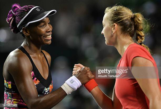 Petra Kvitova of Czech Republic shakes hands with Venus Williams of the United States after winning her women's singles semi final match during day...