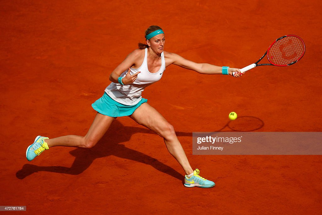 Petra Kvitova of Czech Republic stretches for a forehand in her match against Svetlana Kuznetsova of Russia in the final during day eight of the...