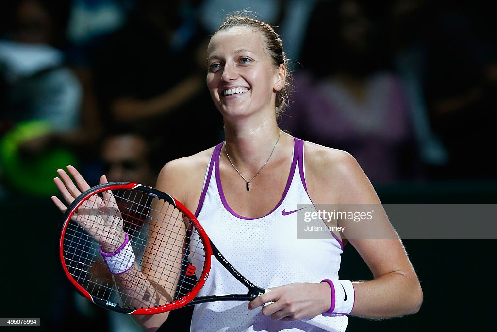 Petra Kvitova of Czech Republic waves to the crowd after defeating Maria Sharapova of Russia in the semi-final match of the BNP Paribas WTA Finals at Singapore Sports Hub on October 31, 2015 in Singapore.