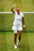 Petra Kvitova of Czech Republic waves to the fans as she celebrates winning the Ladies' Singles final match against Eugenie Bouchard of Canada on day...
