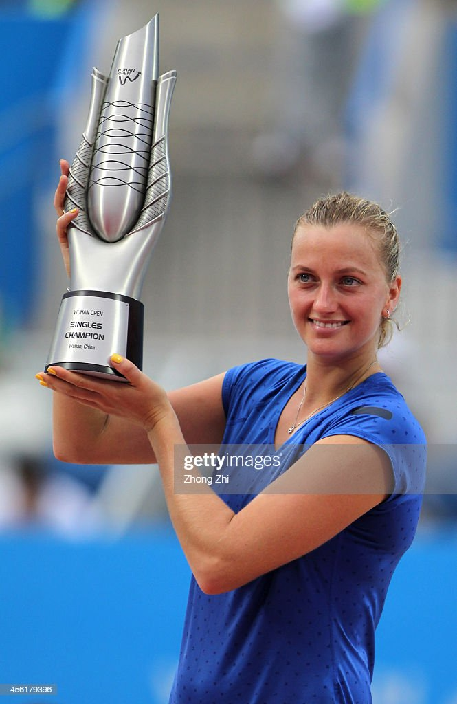 Petra Kvitova of Czech victorious with trophy after winning her final match against Eugenie Bouchard of Canada on day seven of 2014 Dongfeng Motor...