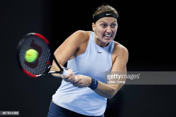 Petra Kvitova of the Czech Repubic returns a shot during the Women's singles thrid round match against Caroline Wozniacki of Denmark Caroline...