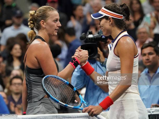 Petra Kvitova of the Czech Republic and Garbine Mugurusa of Spain meet at the net following their 2017 US Open Women's Singles match at the USTA...