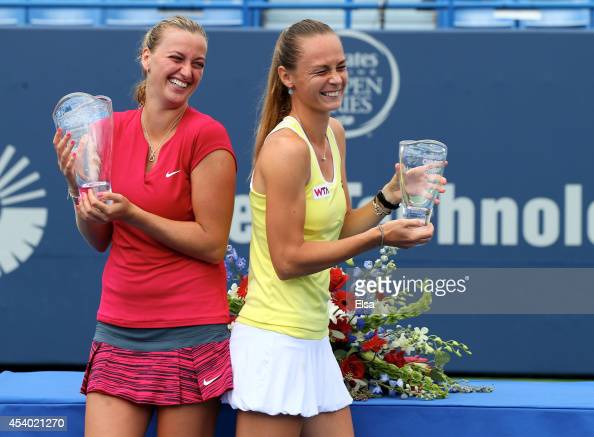 Petra Kvitova of the Czech Republic and Magdalena Rybarikova of Slovakia share a laught as they pose with their trophies after the women's final of...