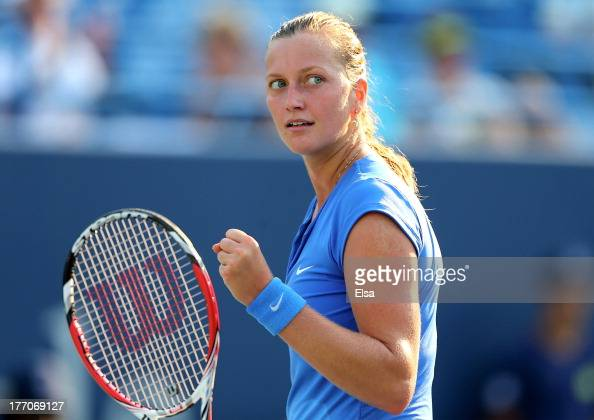 Petra Kvitova of the Czech Republic celebrates a point win in the third set against Annika Beck of Germany during Day Three of the New Have Open at...