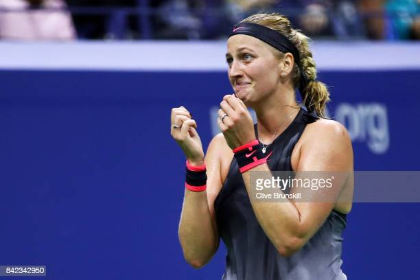 Petra Kvitova of the Czech Republic celebrates defeating Garbine Muguruza of Spain during their fourth round Women's Singles match between on Day...