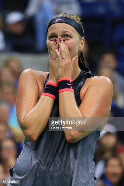 Petra Kvitova of the Czech Republic celebrates defeating Garbine Muguruza of Spain during their fourth round Women's Singles match on Day Seven...