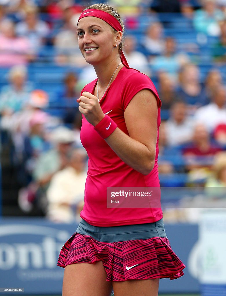 Petra Kvitova of the Czech Republic celebrates her break point win over Magdalena Rybarikova of Slovakia in the final game of the final set of the...