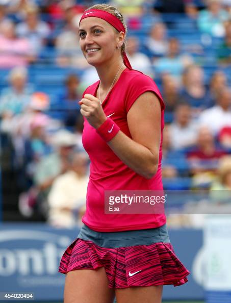 Petra Kvitova of the Czech Republic celebrates her break point win over Magdalena Rybarikova of Slovakia in the final game of the final set of the...