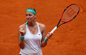Petra Kvitova of the Czech Republic celebrates match point against Serena Williams of the United States in their semi final match during day seven of...