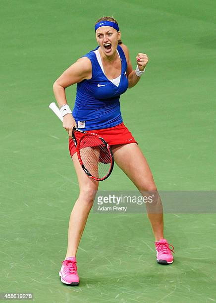 Petra Kvitova of the Czech Republic celebrates victory over Andrea Petkovic of Germany the first rubber of the Fed Cup Final between Petra Kvitova of...
