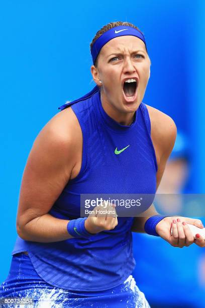 Petra Kvitova of the Czech Republic celebrates winning the second set during the Women's Singles final match against Ashleigh Barty on day seven of...