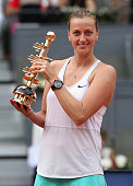 Petra Kvitova of the Czech Republic holds aloft the trophy after her straight sets victory against Svetlana Kuznetsova of Russia in the womens final...