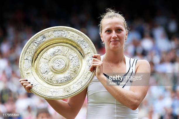 Petra Kvitova of the Czech Republic holds up the Championship trophy after winning her Ladies' final round match against Maria Sharapova of Russia on...