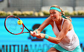 Petra Kvitova of the Czech Republic in action against Svetlana Kuznetsova of Russia in the womens final during day eight of the Mutua Madrid Open...