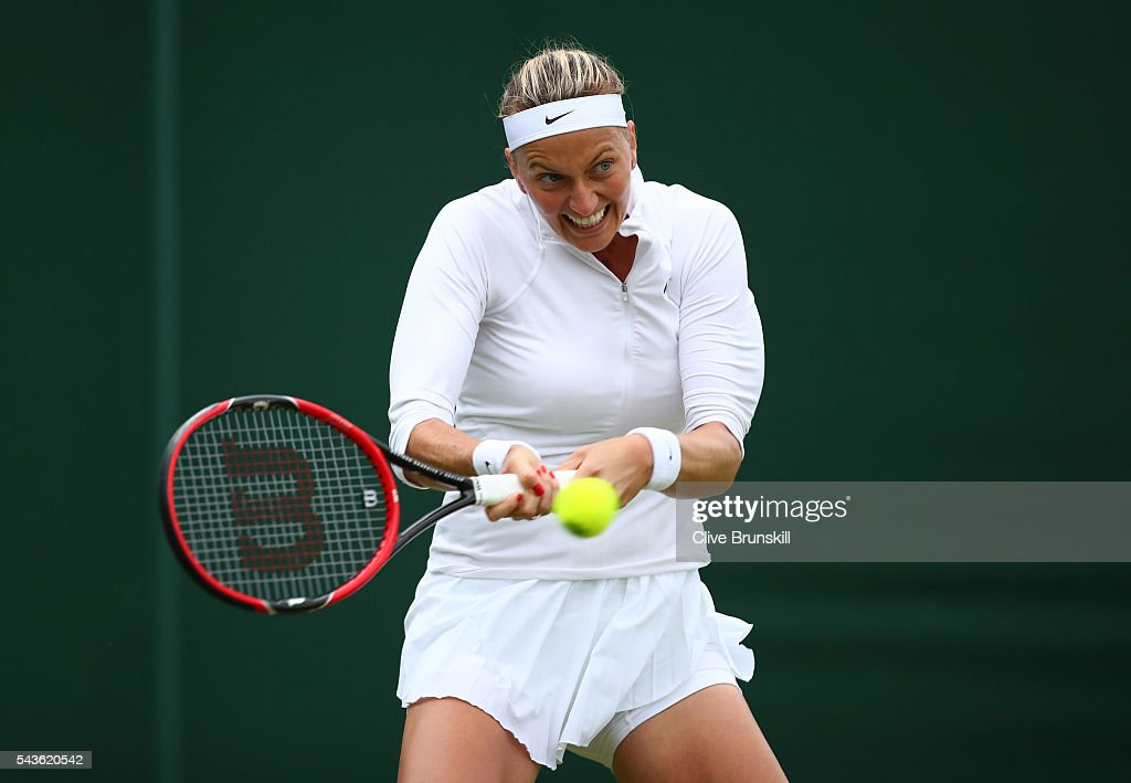 Petra Kvitova of The Czech Republic plays a backhand during the Ladies Singles second round match against Sorana Cirstea of Romania on day three of the Wimbledon Lawn Tennis Championships at the All England Lawn Tennis and Croquet Club on June 29, 2016 in London, England.